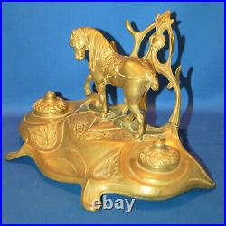 A charming circus horse double inkwell with pen rests, 19th century, brass liner