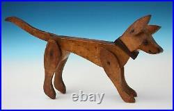 Antique American folk art treen model of an articulated Circus dog