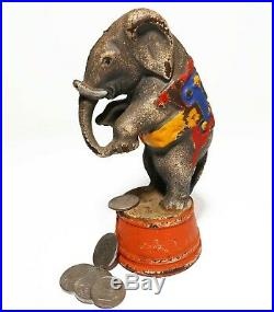 EARLY 20TH C VINT CAST IRON STANDING CIRCUS ELEPHANT BANK, WithORIG ENAMEL PAINT