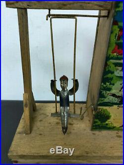 Meiji Era pre-war Japanese tin & wooden wind-up swing circus / baseball antique